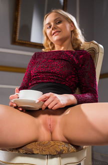 Isabella Star Bends Over The Table